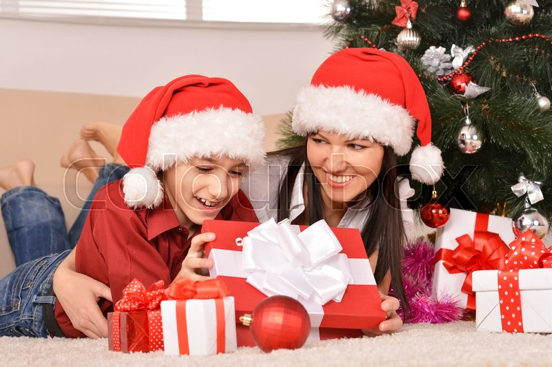 Stock image of 'Cute mom and son in santa hats'