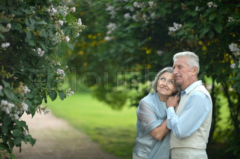 Stock image of 'Happy Mature couple in the park in summer day'