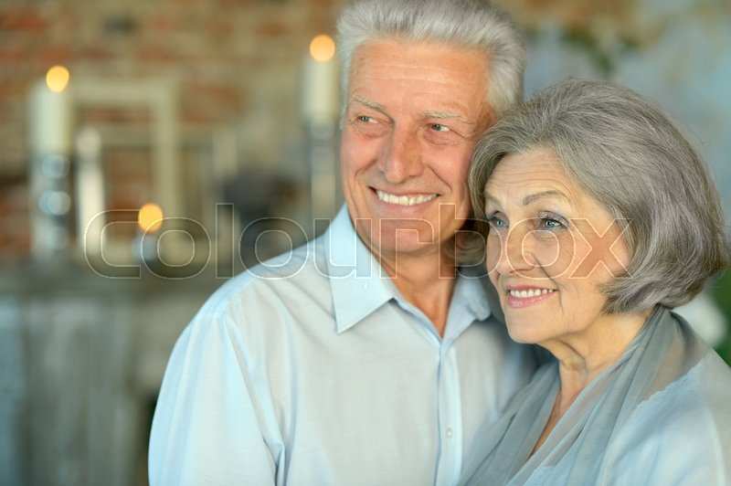 Stock image of 'Portrait of beautiful elderly couple in vintage interior'