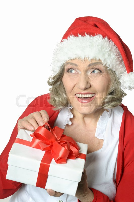 Stock image of 'Senior woman holding a gift on white'