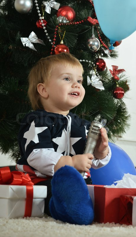 Stock image of 'Portrait of a little boy near new year tree'