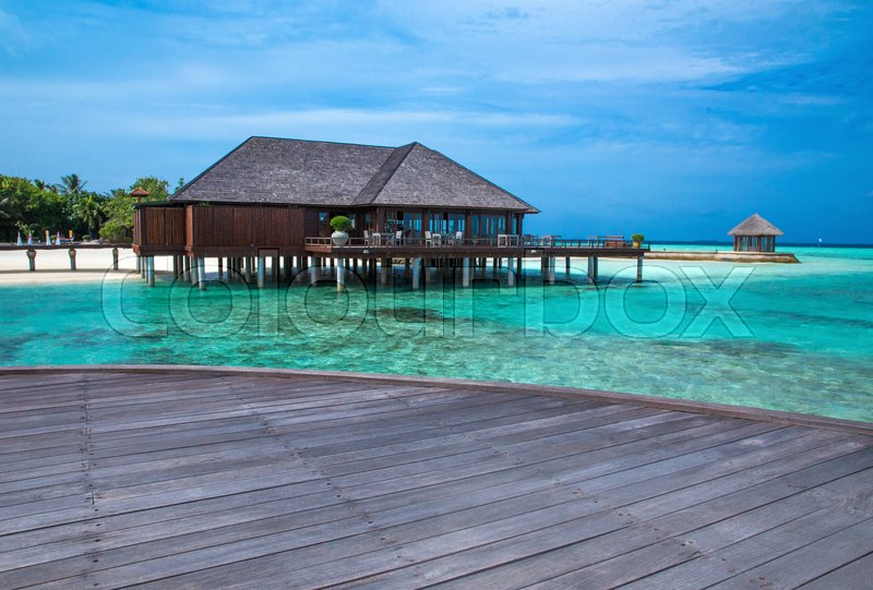 Stock image of 'Beach with water bungalows at Maldives'