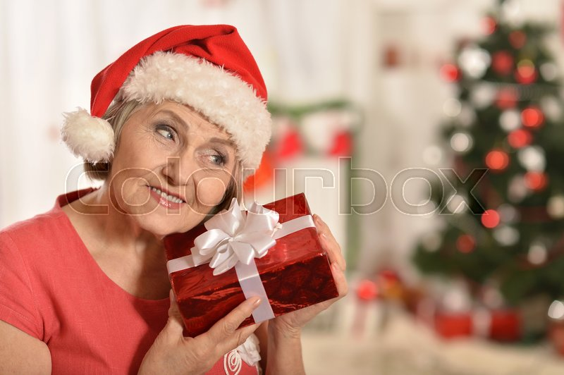 Stock image of 'Portrait of a happy senior woman with gifts'
