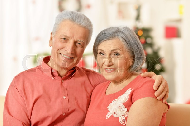Stock image of 'Portrait of amusing old couple at Christmas'