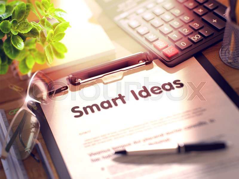 Stock image of 'Smart Ideas on Clipboard. Composition with Clipboard on Working Table and Office Supplies Around. 3d Rendering. Blurred and Toned Image.'