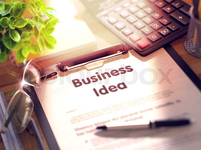 Stock image of 'Desk with Office Supplies Around the Clipboard with Paper and Business Concept - Business Idea. 3d Rendering. Toned Illustration.'