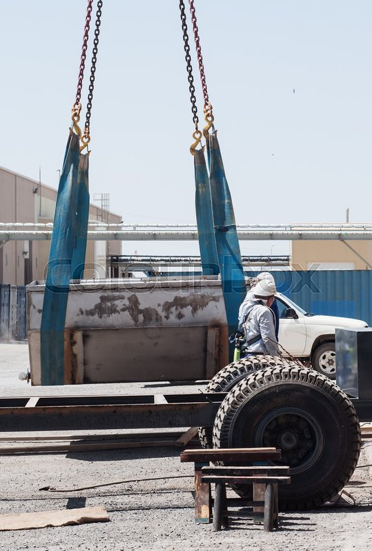 Stock image of 'Unloading by the crane of the production equipment'