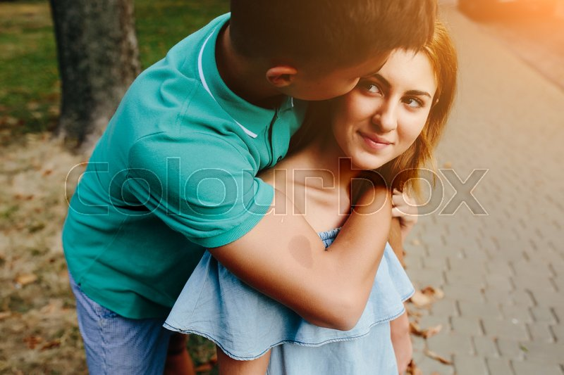 Stock image of 'guy and girl in a park posing on camera, close view'