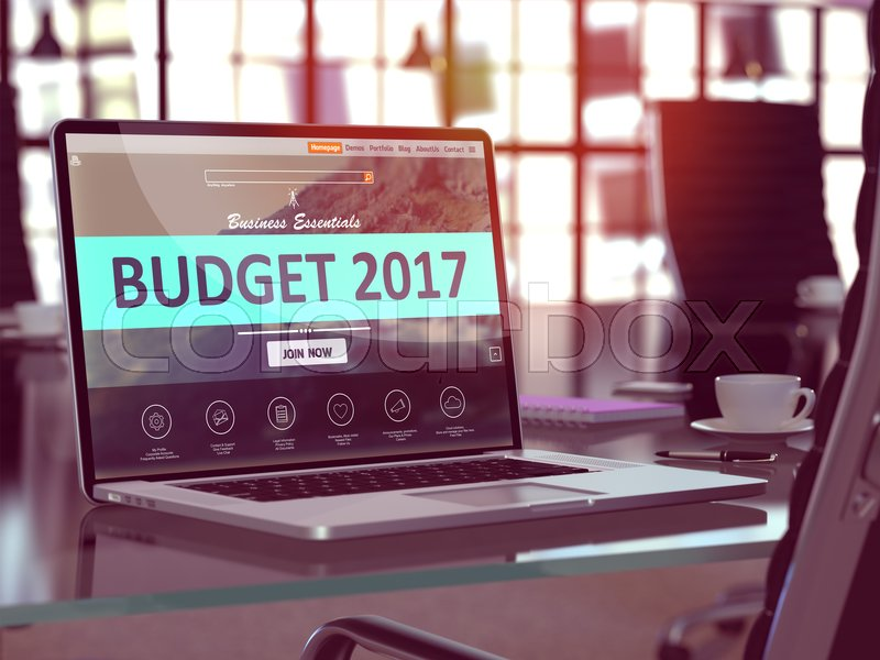 Stock image of 'Modern Workplace with Laptop showing Landing Page with Budget 2017 Concept. Toned Image with Selective Focus. 3D Render.'