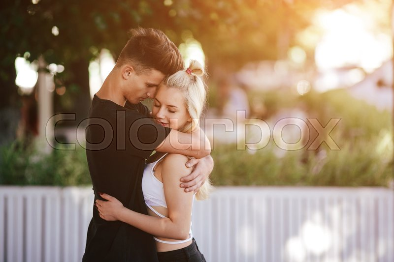 Stock image of 'man and woman hug in the park'