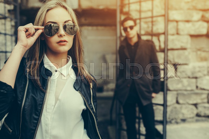 Stock image of 'young beautiful couple posing on the background of an old building'