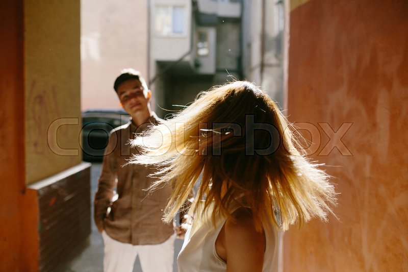 Stock image of 'man and woman posing on the street'