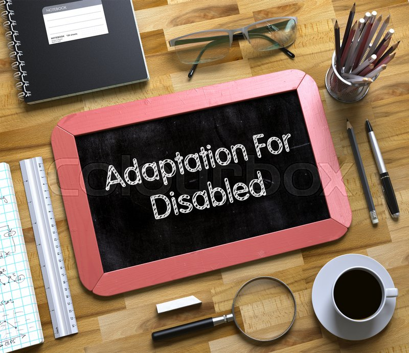 Stock image of 'Small Chalkboard with Adaptation For Disabled. Top View of Office Desk with Stationery and Red Small Chalkboard with Business Concept - Adaptation For Disabled. 3d Rendering.'