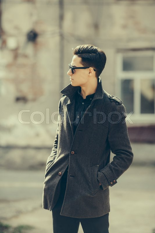 Stock image of 'Young handsome guy posing on a city street'