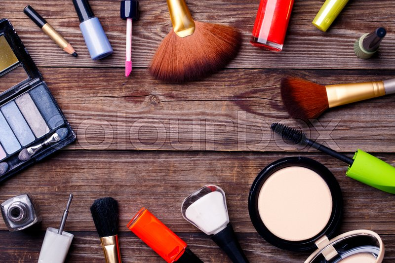 Stock image of 'Makeup cosmetics, brushes and other essentials on brown background'