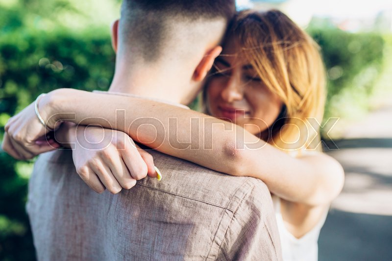 Stock image of 'man and woman in a park posing on camera'