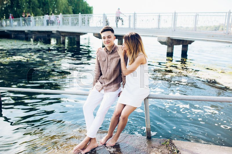 Stock image of 'man and woman posing on the lake at the camera'