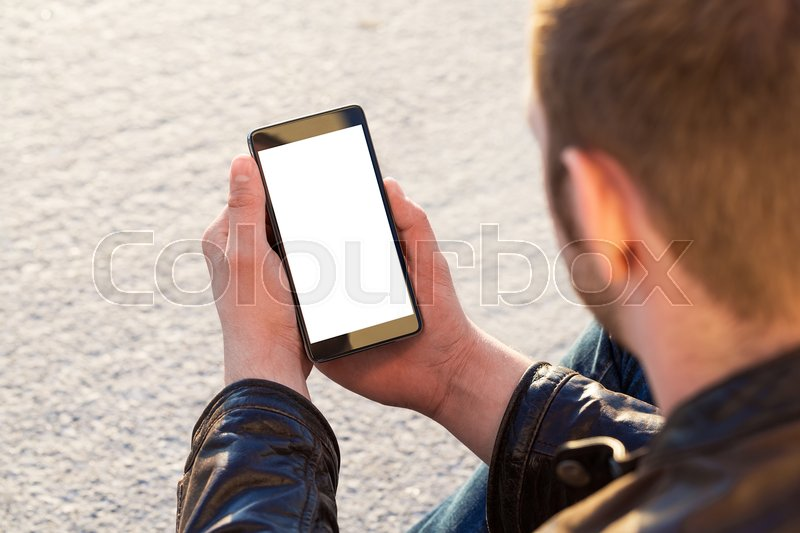Stock image of 'Man uses his Mobile Phone outdoor, close up'