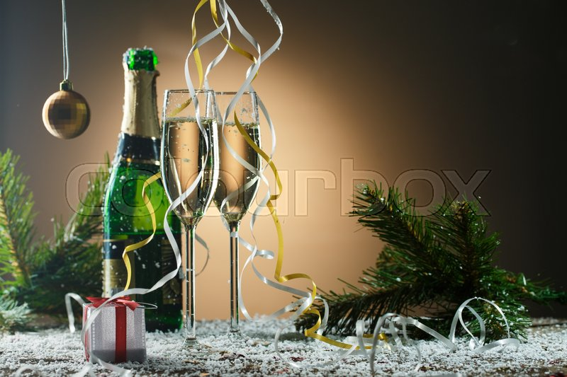 Stock image of 'Beautiful composition with champagne, gift box and Christmas decorations. Romantic holiday concept'