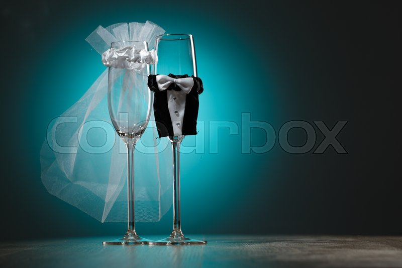 Stock image of 'Stylized champagne glasses in wedding theme. Festive decoration'