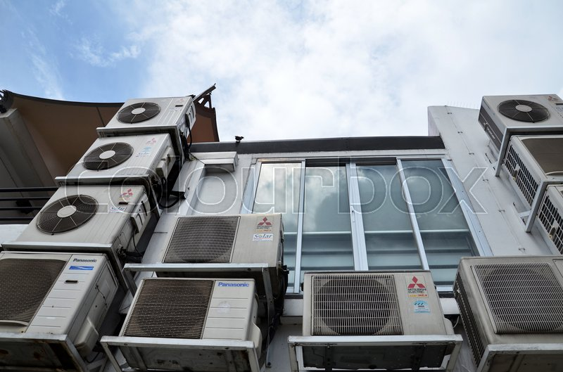 Editorial image of 'SINGAPORE - OCT 16, 2016:  The back of a building on Arab Street in Kampong Glam is covered with multiple air-conditioning unit fans'