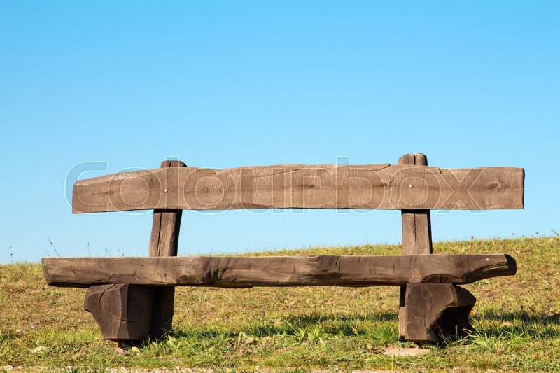 Stock image of 'Wooden bench with the look at blue sky '