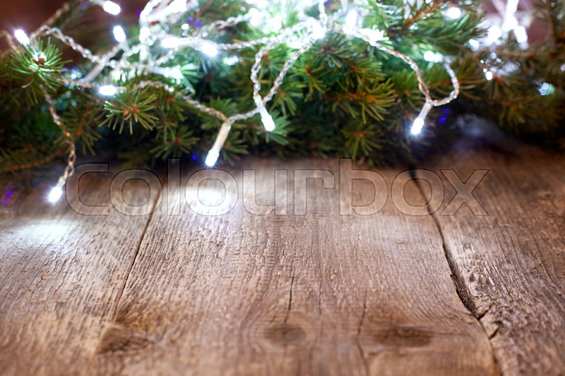 Stock image of 'Christmas composition with old wooden background, Christmas tree and garland'