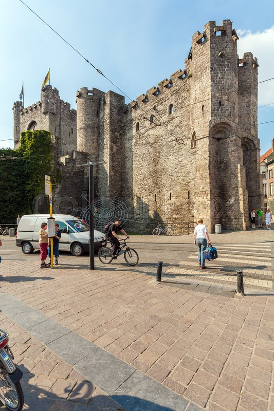 Editorial image of 'GHENT, BELGIUM - APRIL 6, 2008: A cyclist rides in front of medieval castle Gravensteen'