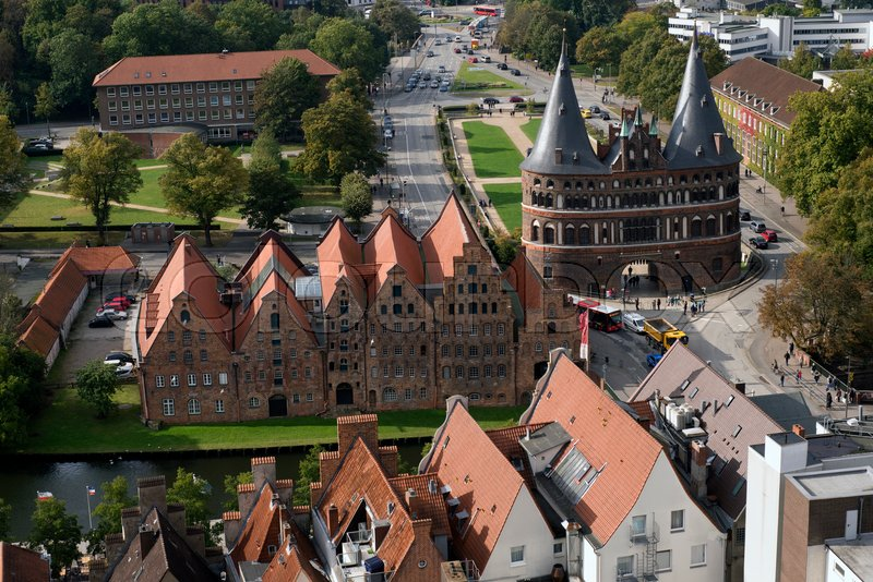 Editorial image of 'LUBECK, GERMANY – OCTOBER 13, 2016: Aerial view of Lubeck with the Holsten gate and Salzspeicher (salt storehouses). Lubeck is listed by UNESCO as a World Heritage Site.'