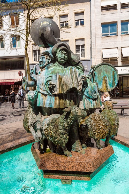 Editorial image of 'LUXEMBOURG - APRIL 7, 2008: Hammelsmarsch Fountain, with Musicians playing sheep march in the city center'