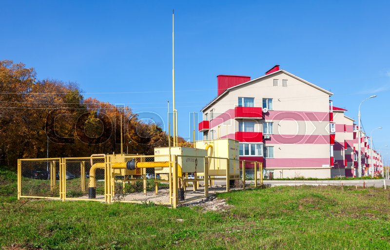 Editorial image of 'SAMARA, RUSSIA - OCTOBER 9, 2016: Gas regulatory and distribution point near the apartment house. Text on russian: Flammable, gas'