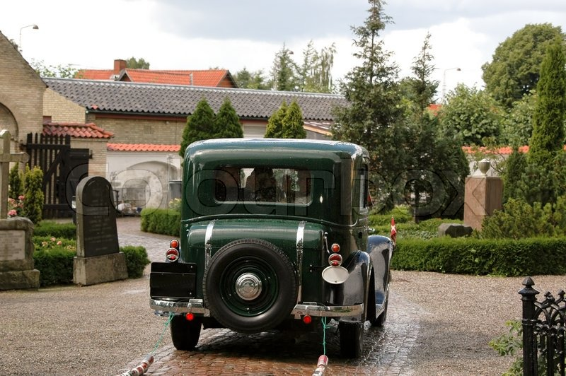 old car is driving the wedding couple away l stock photo colourbox