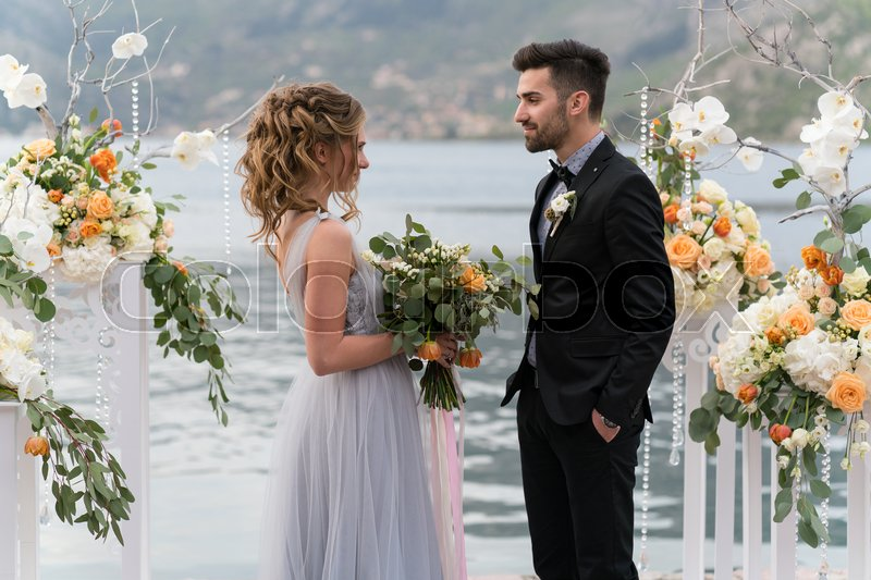 Stock image of 'beautiful caucasian couple just married on the seashore'