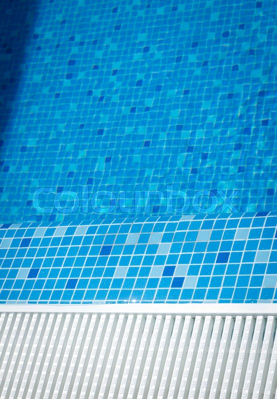 Stock image of 'Outdoor swimming pool water on hot summerday in luxury hotel.'
