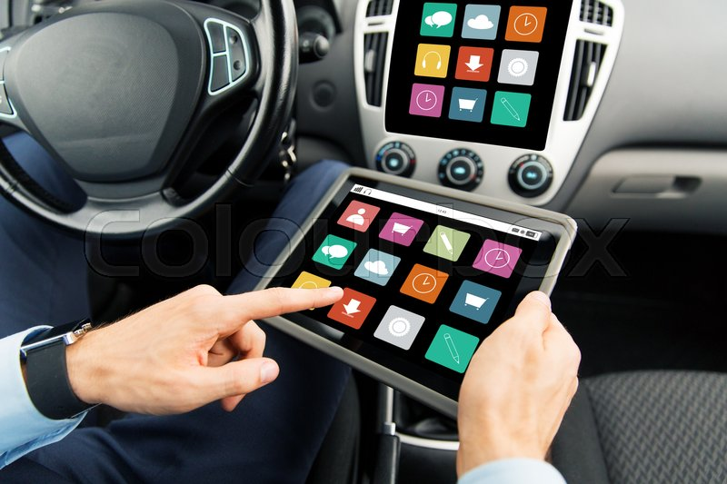 Stock image of 'transport, business trip, technology, media and people concept - close up of male hands holding tablet pc computer with menu icons on screen in car'