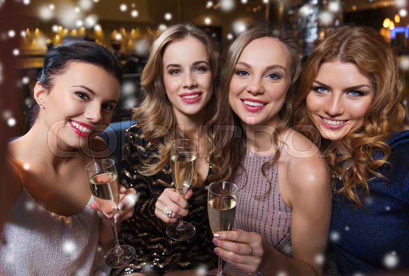 Stock image of 'friends, bachelorette party, technology and holidays concept - happy smiling young pretty women with champagne glasses taking selfie at night club'