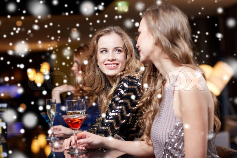 Stock image of 'celebration, friends, bachelorette party and holidays concept - happy women drinking champagne and cocktails at night club'