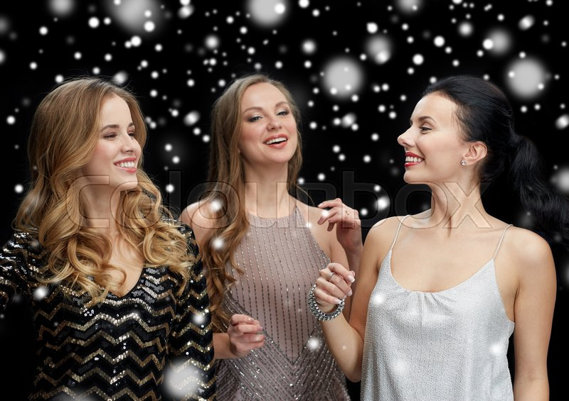 Stock image of 'party, holidays, nightlife and people concept - happy young women dancing at night club disco over black background'