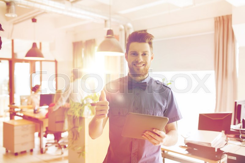 Stock image of 'business, startup and people concept - happy businessman or creative male office worker with tablet pc computer'