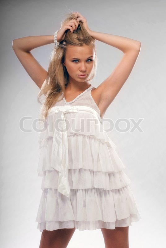 75c8798b5890 A young beautiful blonde in white short ... | Stock image | Colourbox