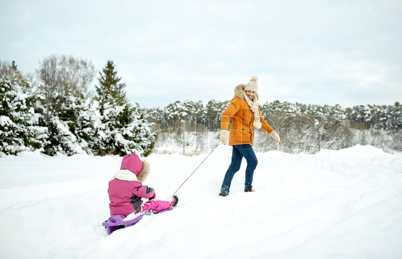 Stock image of 'family, sledding, season and people concept - happy father pulling sled with child outdoors in winter'