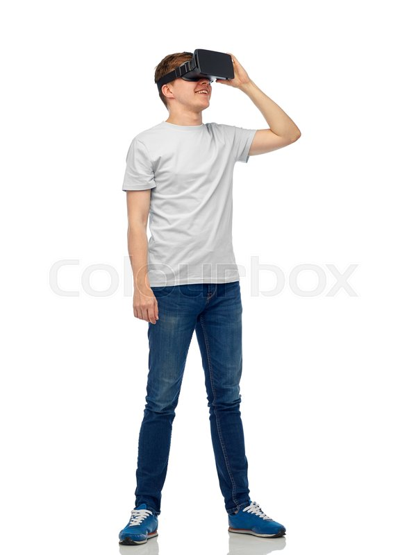 Stock image of '3d technology, virtual reality, entertainment, cyberspace and people concept - happy young man with virtual reality headset or 3d glasses'