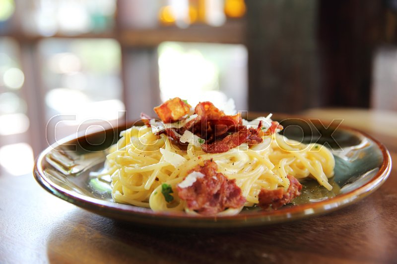 Stock image of 'Spaghetti Carbonara with bacon and cheese'
