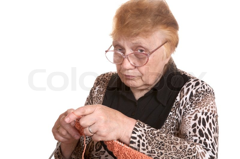 Old Grandma Knitting : The old woman is engaged in knitting on a white background