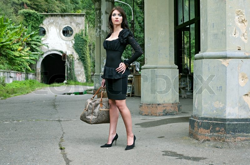 Beauty Brunette Woman In Abkhazia Railway Station With Bag