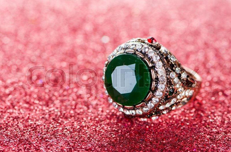 Jewellery concept with ring on shiny background, stock photo