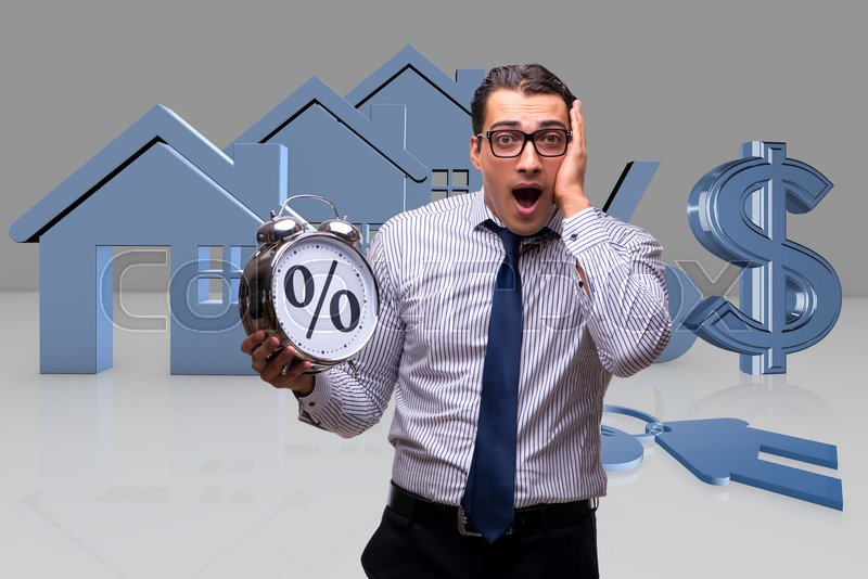 Young businessman surprised at high interest mortgage rates, stock photo