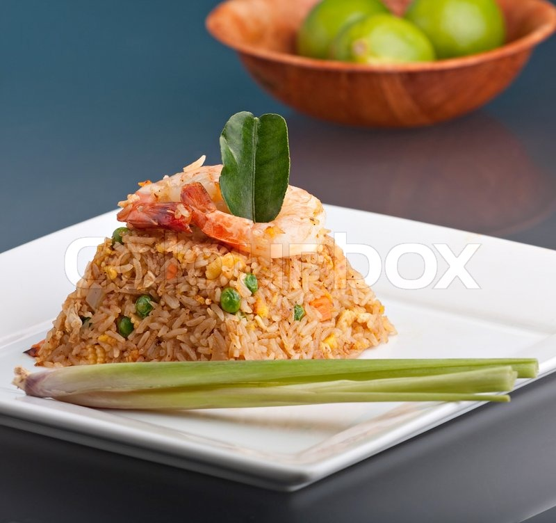 A thai dish of shrimp fried rice presented on a square white plate a thai dish of shrimp fried rice presented on a square white plate in the shape of a pyramid stock photo colourbox ccuart Image collections