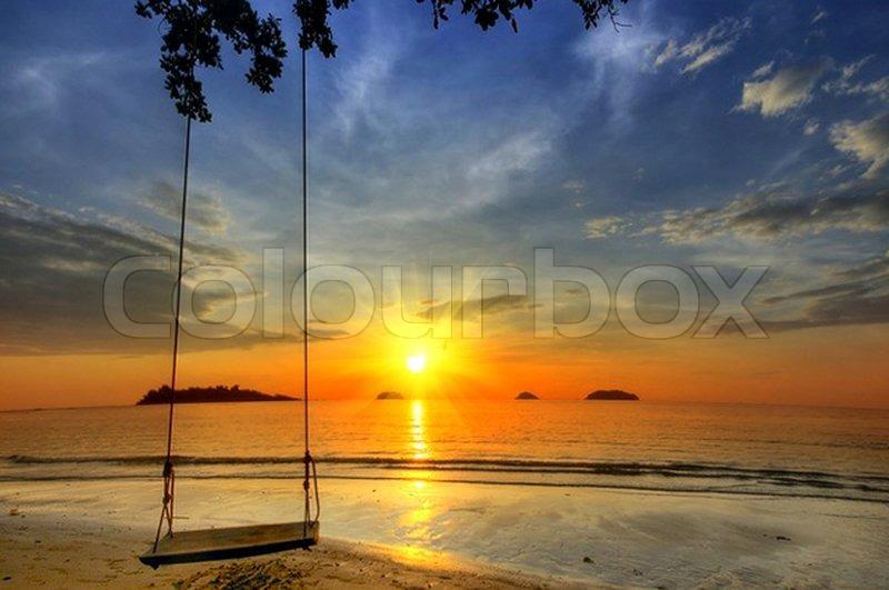 Swing On Paradise Sunset On The Beach Stock Photo