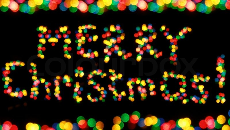 colorful garland lights looking as words merry christmas stock photo